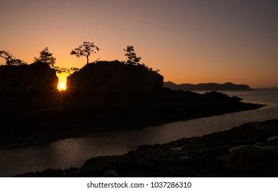 Sunrise between islands and islands