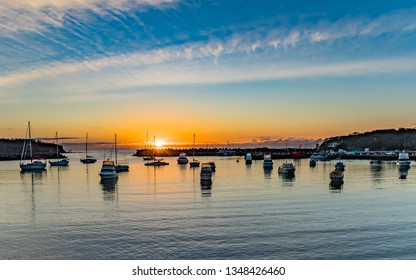 Sunrise and boats in the harbour - Taken at Ulladulla Harbour on the South Coast of NSW, Australia.