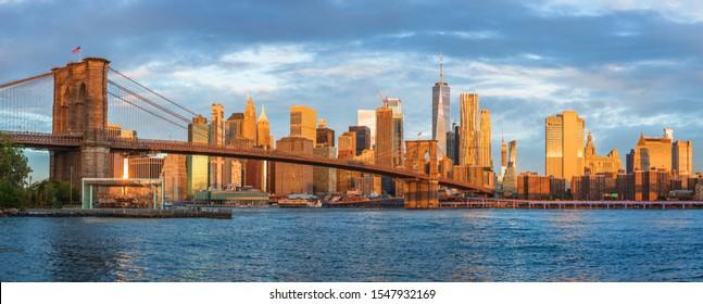 Sunrise at Brooklyn Bridge Park with view to Manhattan Skyline.