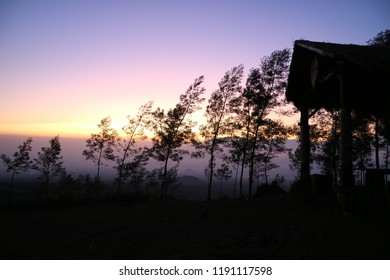 Sunrise in Budug Asu Peak Malang Indonesian