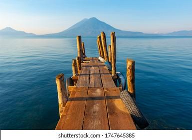 Sunrise by the Atitlan Lake with an embarkation pier, Panajachel, Guatemala.