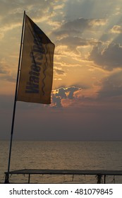 Sunrise by the water sports flag