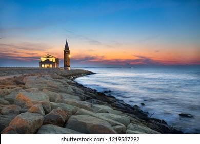 Sunrise in Caorle, Santuario Madonna dell' Angelo, Venice province, Veneto, Italy.