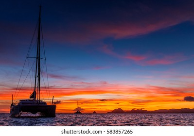 Sunrise in Caribic with catamaran in front of view