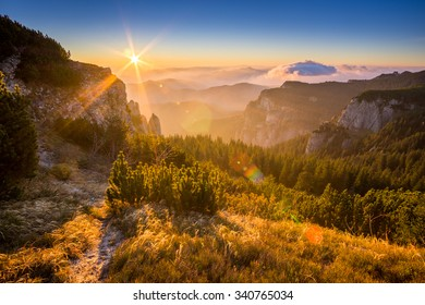 sunrise in ceahlau mountains in a windy morning