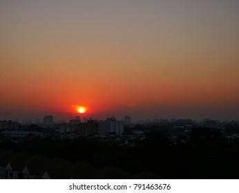 Sunrise in city