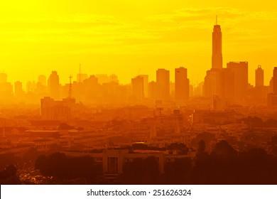 Sunrise at city of Bangkok, Thailand, unfocused