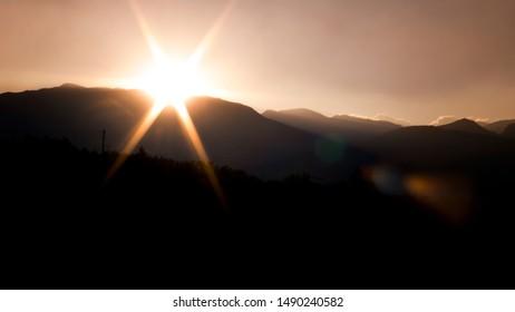 Sunrise in the city of Kalamata behind its mountain range of taygetos