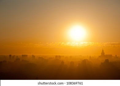Sunrise at the city. Silhouette of buildings.