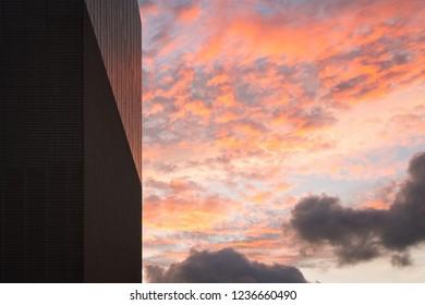 Sunrise cloud beside the building