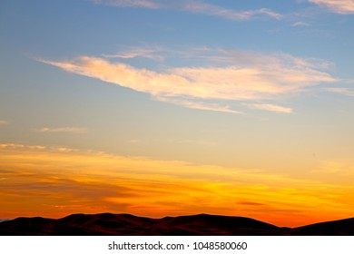 sunrise  in the colored sky white soft clouds and abstract background