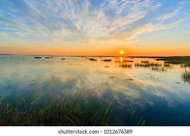 Sunrise colors in Danube Delta where Sulina Channel meet Black Sea in Romania. View from kayak.