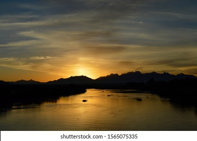 sunrise coming up over Organ Mountains and Rio Grand River