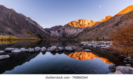 Sunrise at Convict Lake, part of California Eastern Sierra. Nice water reflection and golden fall foliage.