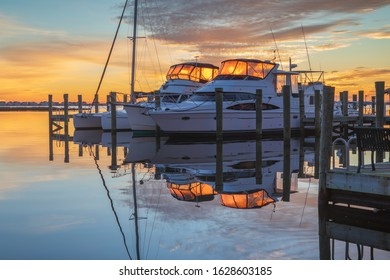 Sunrise creating a lantern effect in boats docked at the  Manteo Waterfront Marina on the Outer Banks of North Carolina.