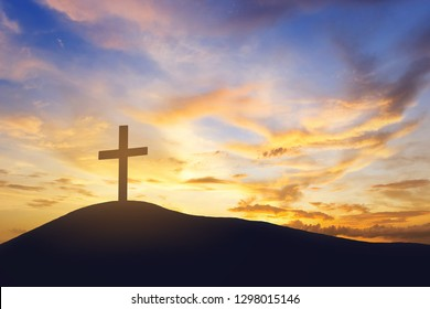 sunrise and cross on mountain