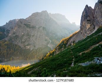 Sunrise in Dolomites mountains in autumn