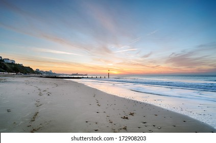 Sunrise at Durley Chine on Bournemouth Beach with the pier in the distance