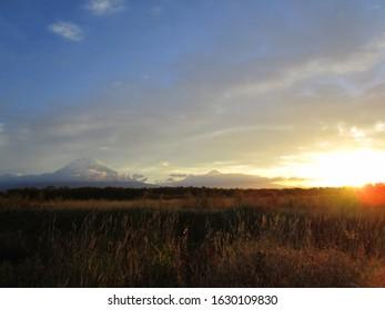 sunrise at the edge of volcanoes