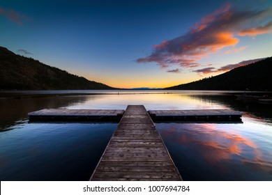 Sunrise at Fallen Leaf Lake.  Pier with clouds reflecting in water.  Lake Tahoe, California