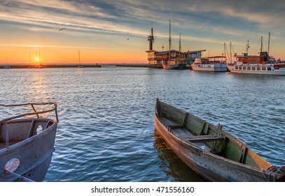Sunrise at the famous marine port in resort city of Nida, Lithuania, Europe