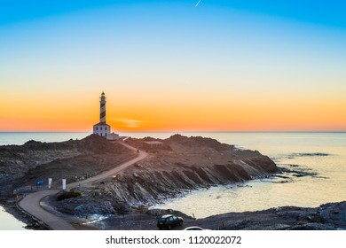 Sunrise in Favaritx Lighthouse on Minorca Island north eastern shore, Balearic Islands, Spain.
