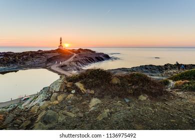 Sunrise in Favaritx Lighthouse on Minorca Island north eastern shore, Balearic Islands, Spain.