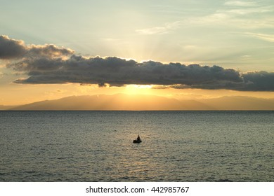 Sunrise and fishing boat