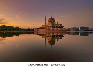 Sunrise floating mosque in Putrajaya reflected on Putrajaya Lake