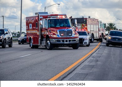 Sunrise, Florida/USA - July 16, 2019: Car Accident, some peoples was injured, three cars was smashed. Police Officer investigate accident. Sunrise Fire-Rescue Department workers maintained scene.
