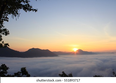 Sunrise and foggy at the top of Phutok, Loei, Thailand