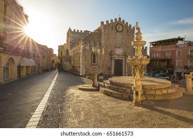Sunrise at Fontana di Piazza Duomo and Umberto Corso street in Taormina, Sicily island, Italy