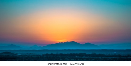 Sunrise frame and the layers of mountain from Arabian desert of Saudi Arabia.
