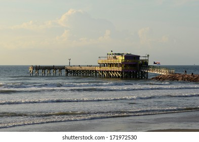 Sunrise in Galveston Texas and a restaurant pier in the Gulf of Mexico