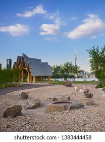Sunrise Garden Pavilion at Trillium Park in Toronto, Canada. The provincial park was developed along Lake Ontario. In background the Toronto skyline with the CN Tower is visible.