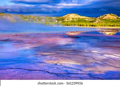 Sunrise at Grand Prismatic Spring in Yellowstone National Park.