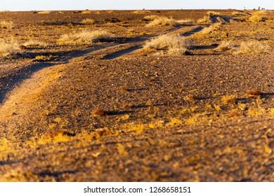 Sunrise gravel road in Gobi desert, Inner Mongolia, China