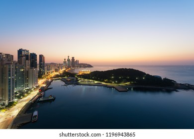 Sunrise at Haeundae beach in Busan. Haeundae beach is Busan's most popular beach in South Korea.