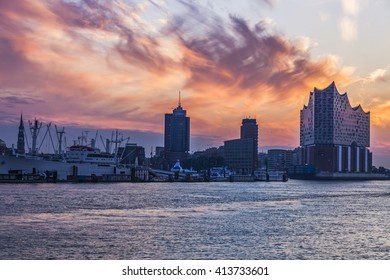 Sunrise in Hamburg - seen accros Elbe River. Hamburg, Germany