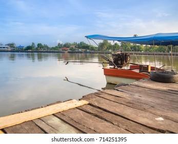 Sunrise at Harbor, Cruise, scenery and life way community waterfront Amphawa Floating Market Samut Songkhram Province Thailand.