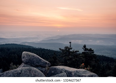 Sunrise in harz mountains on cliff