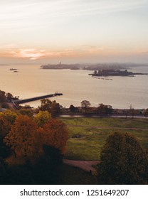 Sunrise in Helsinki Finland with Suomenlinna in the horizon with fog on an empty morning