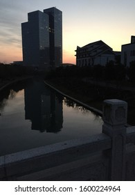 Sunrise highrise reflected in the canal