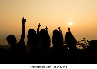 Sunrise with his arms outstretched