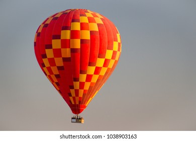 Sunrise hot air balloon ride in Cappadocia region in  Turkey. Beautiful and colorful balloon.