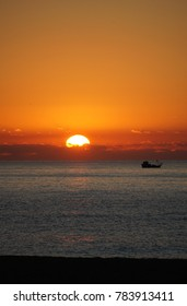 Sunrise images with fishing boats captured at the beach of Calella Barcelona.