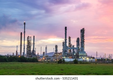 The sunrise industrial that construct under the light colorful sky.