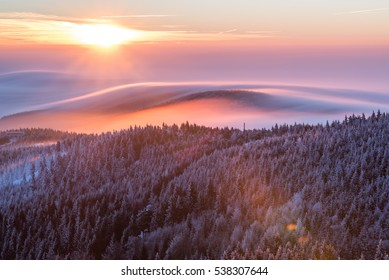 Sunrise and Inversion at Jested mountain close town Liberec, Czech republic
