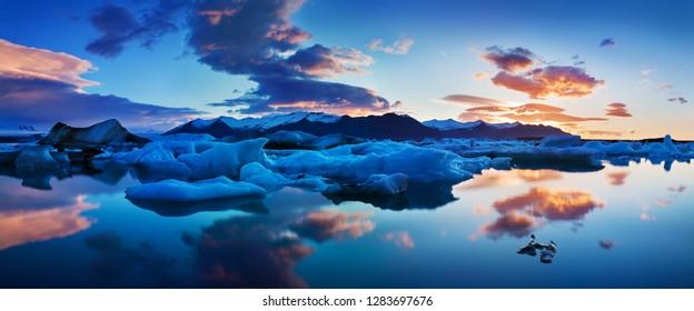 Sunrise in Jokulsarlon. icelandic ice lagoon of jokulsarlon in the morning in summer or winter. Blue icebergs floating in Jokulsarlon Glacier Lagoon, early winter in south Iceland