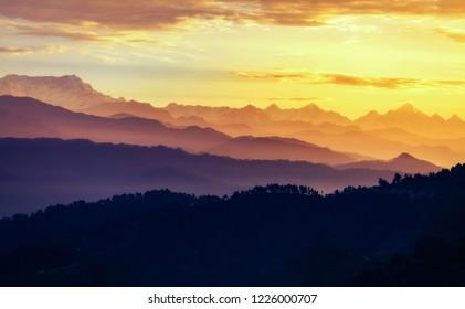 Sunrise at Kausani Uttarakhand India with view of mountain ranges and Himalaya snow peaks